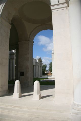 View 1 showing entrance courtyard wtih Flying Services Memorial at right edge of archway and Foubourg D'Amiens Cemetery