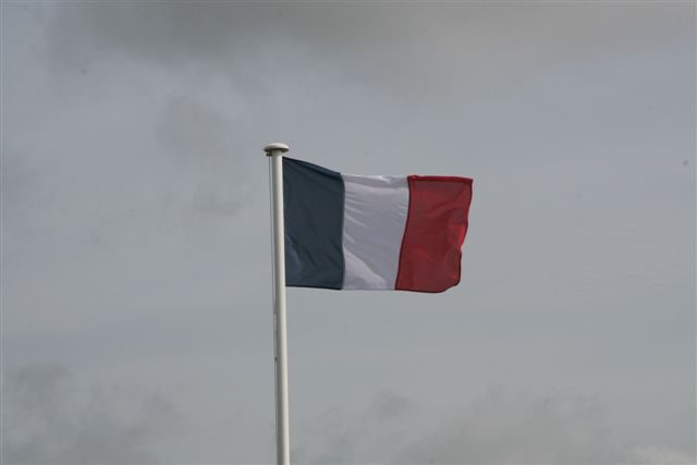 French flag flying over Aubigny Communal Cemetery