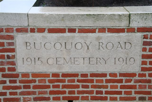 Name inscription on cemetery wall